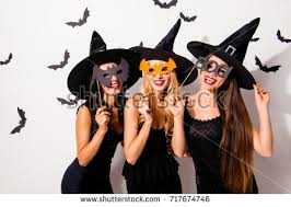 masquerade dresses and masks three diverse charming coquettes stock photo 717674746