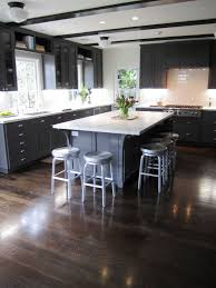 thin celing beams kitchen cococozy exclusive kitchen with dark grey cabinets and drawers school house lighting stained wood beams marble counter tops floor metal barstools around