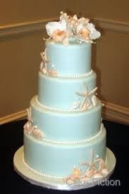 cake fiction seashells and cattleya orchids wedding cake