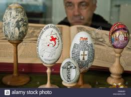 Decorating Easter Eggs Around The World by Cottbus Germany 5th Mar 2014 A Visitor Examines A Set Of