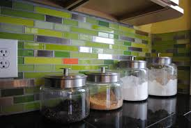green tile kitchen backsplash linear subway green tile with hints of stainless steel and orange