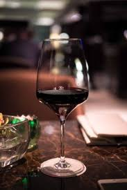 glass of wine having a glass of wine picture of sofitel philippine plaza