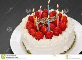 birthday cake with burning candles royalty free stock image