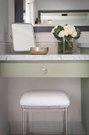 green makeup vanity with terry cloth stool transitional bathroom