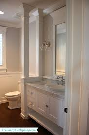 powder bathroom half walls wainscoting and division