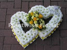 funeral ribbon based open heart with ribbon edge funeral flowers canvey is
