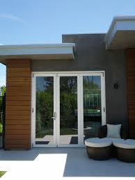 accordion doors glass house exterior design with white frame bi folding glass door