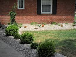 luck landscaping flower beds with river rock