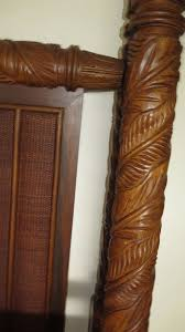 ornate carved four posted bed w woven rattan headboard tropical