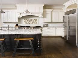 two tones espresso kitchen cabinets with white island for chevron