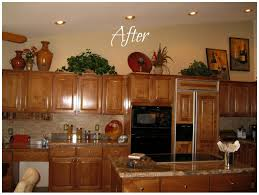 Above Kitchen Cabinet Decorations Kitchen Cabinet S Top Photo 1 Kitchen Decorating Ideas Above