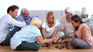 extended family chess at home on sitting room floor stock