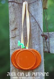 easy pumpkin craft idea using juice can lids turning the clock back
