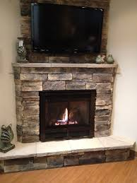 corner fireplace with tv hung above with furniture layout