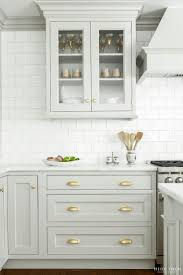 love the grey contrast molding with subway tile kitchen