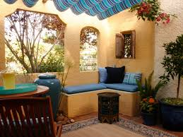 the porch on a spanish bungalow gets a color upgrade with tones of