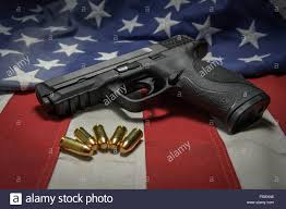 A American Flag Pictures Gun With Ammo With A American Flag Background Stock Photo Royalty