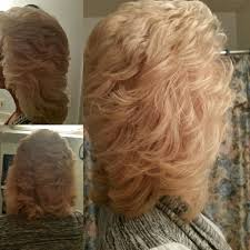 feathered brush back hair cut so it can feather back blended layers to length hair by