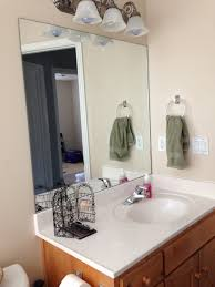 How To Frame A Bathroom Mirror With Crown Molding Diy Bathroom Mirror Frame Sawdust Sisters