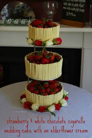 strawberry and white chocolate wedding cake with an elderflower