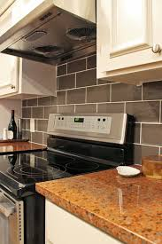 Subway Tile Backsplash In Kitchen Contemporary Kitchen With Red Granite Countertops And Gray Subway
