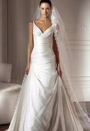 silk fit and flare wedding dress pronovias light ivory silk dupioni vneck empire ruching fit flare