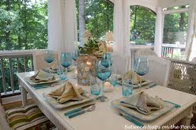 a beach themed table setting with a starfish napkin fold