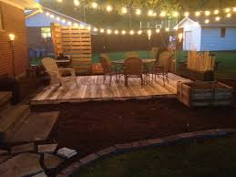 here is my version of a pallet deck it was hard work making