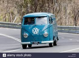 van volkswagen vintage vintage 1959 volkswagen kombi van driving on country roads near