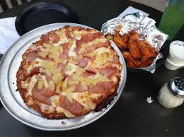 does round table deliver hawaiian pizza delivery to local resorts with 20 order