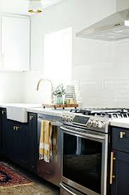 moen renzo kitchen faucet minimalist white tile backsplash and cabinet for modern