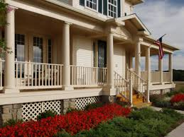 a wraparound neutral porch contrasts beautifully with bright red