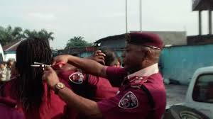 female punishment haircuts stories nigeria road safety commander cut hair of female employees bbc news