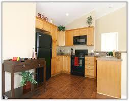 Light Wood Kitchen Cabinets Dark Wood Kitchen Cabinets With Dark Wood Floors Home Design Ideas