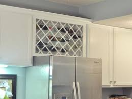 kitchen cabinet wine rack ideas how to decorate the space above your kitchen cabinets wine