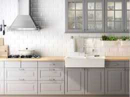 grey cabinets brass pulls marble backsplash sophie burke design