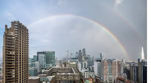 london rainbow of hope appears over london bridge days after