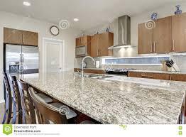 large kitchen island in modern open plan kitchen stock photo