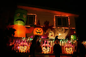 decorate house for halloween with jack o lanterns and string