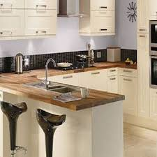 homebase kitchen furniture painted shaker kitchen with oak breakfast bar and quartz