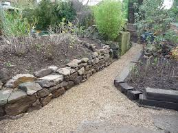 garden landscaping with dry stone walling brighton arbworx