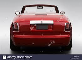 rolls royce rear 2008 rolls royce drophead coupe in red low wide rear stock photo