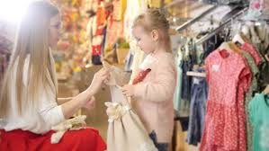 shopping for kids cute little with mommy buying in