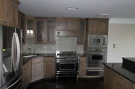 gray knotty alder cabinets kitchen