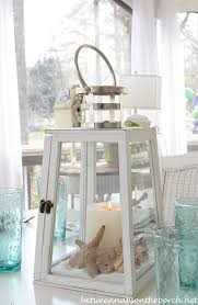coastal centerpieces themed table setting tablescape with lighthouse lantern and