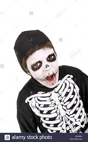 boy with face paint and skeleton halloween costume isolated in