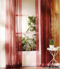 vintage style interior design with thin red sheer curtains and