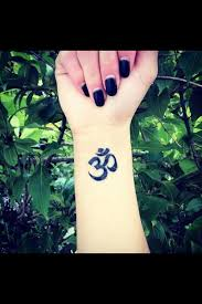 46 om tattoo on wrists