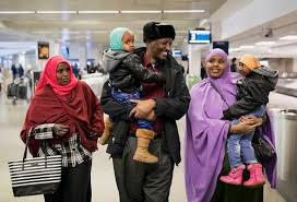 Minnesota can americans travel to iran images Reunions and protests as travel ban winds through courts jpg
