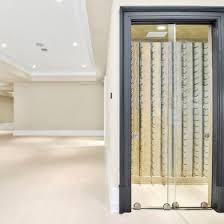 elegant contemporary basement wine cellar with vertical wine racks